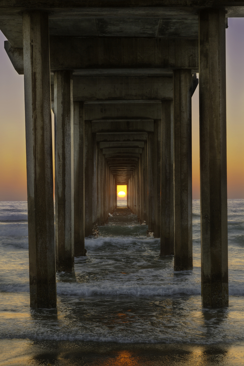 Sunset under Scripps Pier in San Diego by Thomas Piekunka
