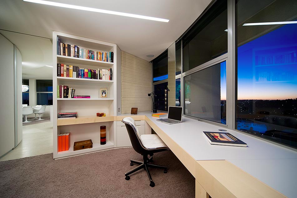 Your home office? A bookcase, a desk, a laptop and a view.