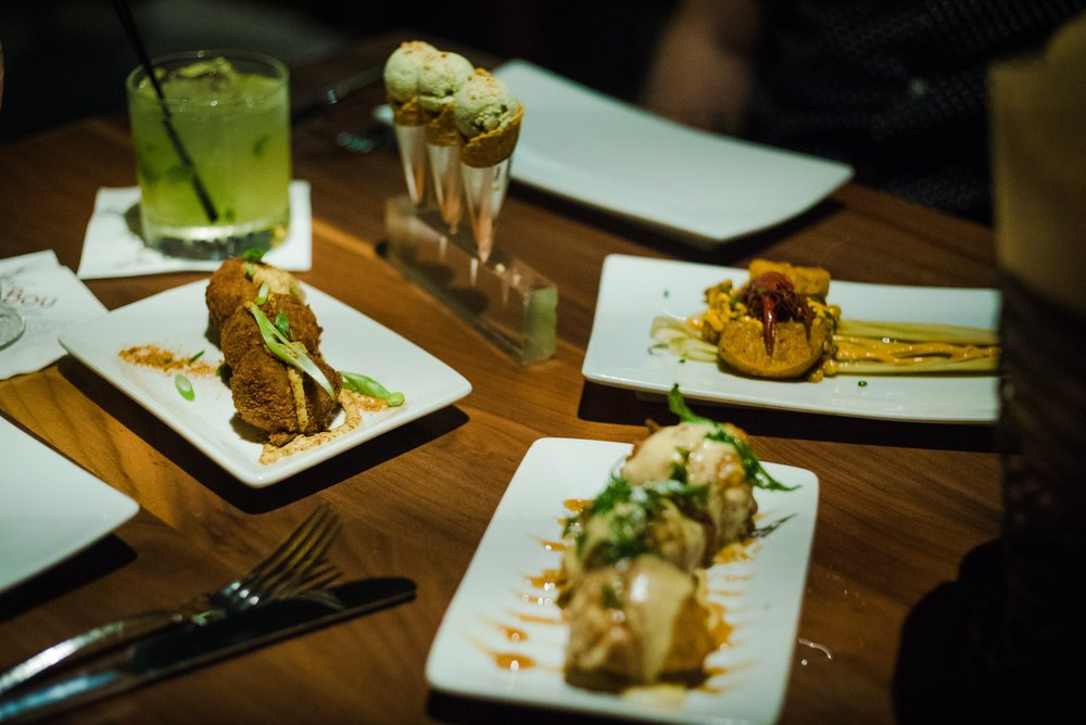 Creative masterpieces from Sobou's chef Juan Carlos: (from top left) Yellowfin Tuna Cones; Crawfish Tamale; Sweet Potato Beignets; Boudin Balls; and a glass of Sunset in the Courtyard. There was a lot going on here, but somehow, it worked! The flavors were amazing.