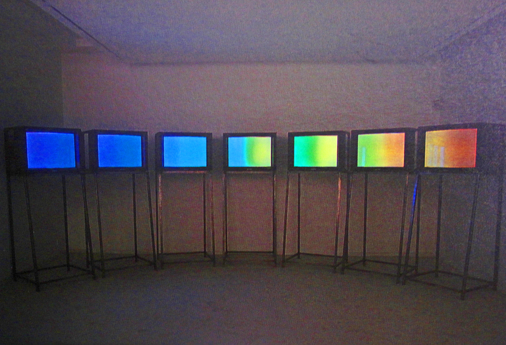 Descry 1992, installation, video 10minute loop, white carpet, convex lens. First shown Kettles Yard, then Kunstewerke Berlin, Bluecoat Liverpool...