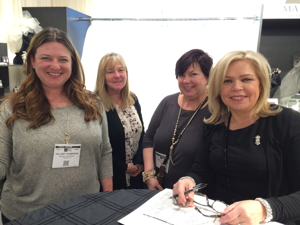 Stacey (just behind always smiling Vela (R)) and staff from Bridal Elegance of Torrance CA.