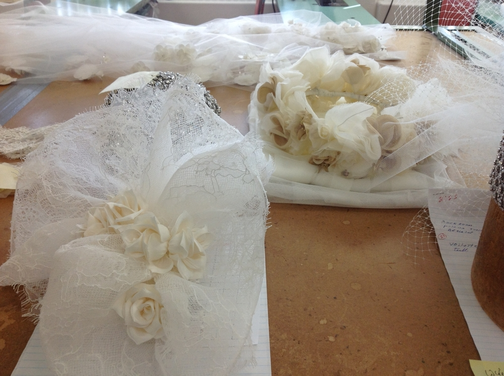 FINISHING  - Whether it be the application of crystals, organza or satin flowers, Chantilly lace, or embroidered appliqués, these finishing touches are what gives each veil its unique character.
