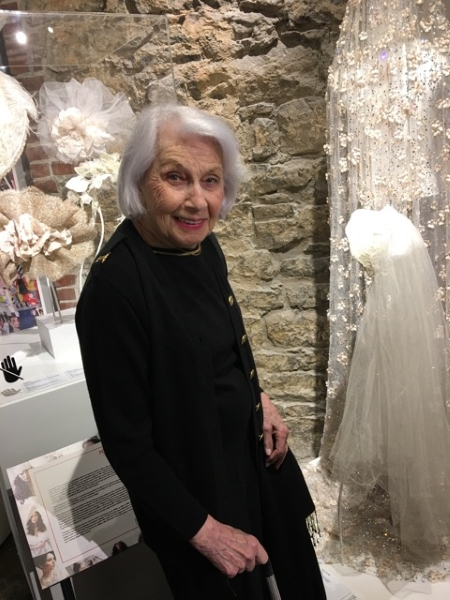 Miriam Henderson (can you believe she's 92!), whose husband Dan founded Malis-Henderson poses in front of the headpiece and veil she wore at her wedding in 1946.