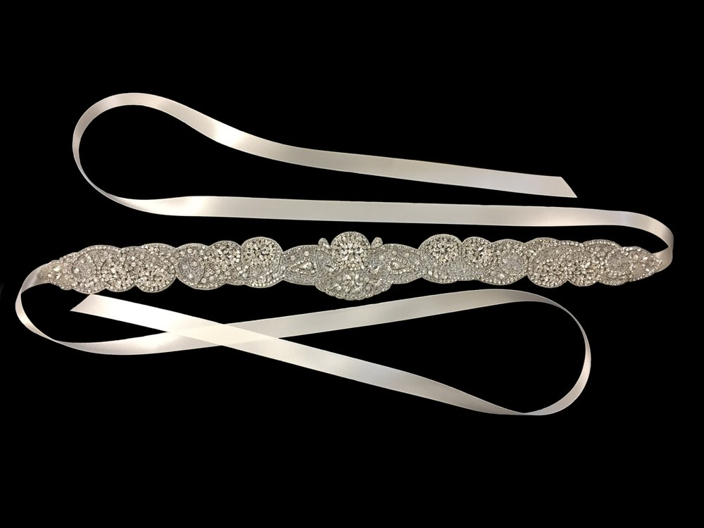 "All styles are meticulously hand-beaded and tie with a 5/8"" Double-face Satin Ribbon."