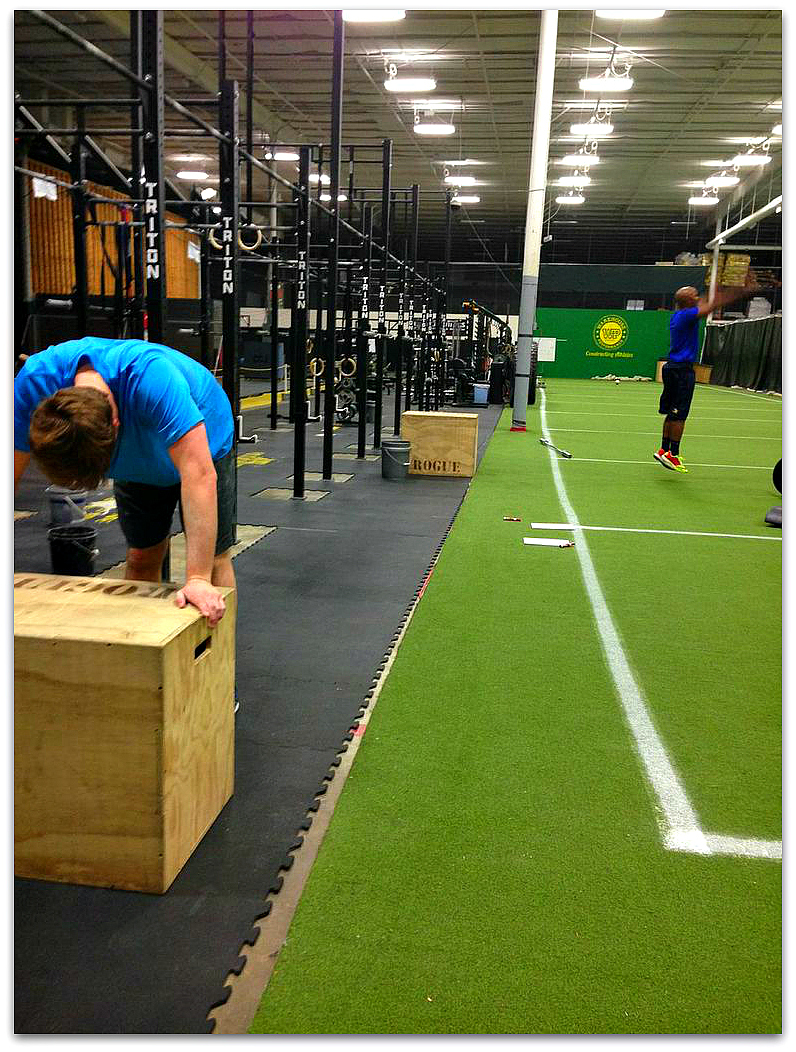Jerime and Will thoroughly enjoying the final round of  box jumps and burpees for Monday's WOD.