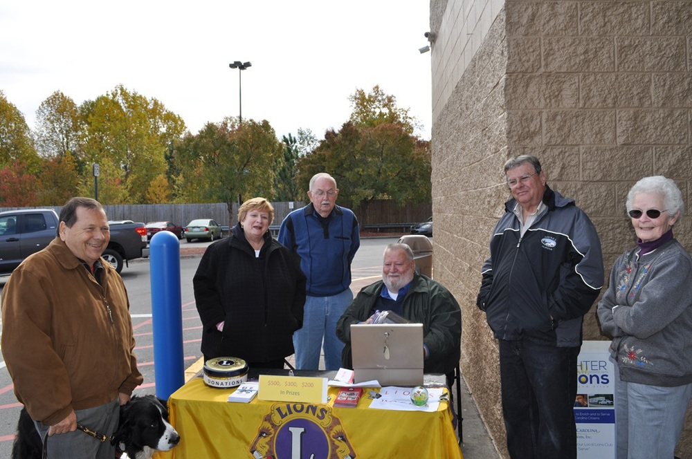 Lions Bob, Nancy, Keith, Chuck, Jim and Fran get ready to pick the raffle winners in front of Wal-Mart, Aberdeen NC.