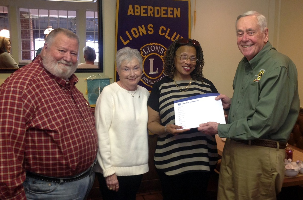 President Chuck, Sponsor Lion Barbara and PDG Brad welcome in the Aberdeen Lions newest member, Lion Dorothy Frye.