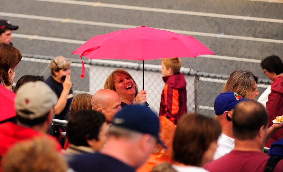 Fans leave the field at Christiansburg High School after lightning delay during Friday's game. Players were even able to take the field before lighting was visible and officials put the game on delay. RYAN STONE | Special to The Roanoke Times
