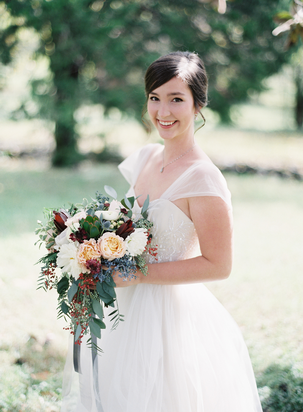 Organic, natural bridal bouquet with roses, berries, and protea // Nashville Wedding Florist