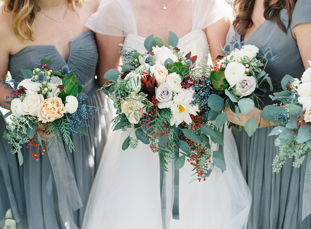Bouquets with berries, protea, roses, and dahlias // Nashville Wedding Florist