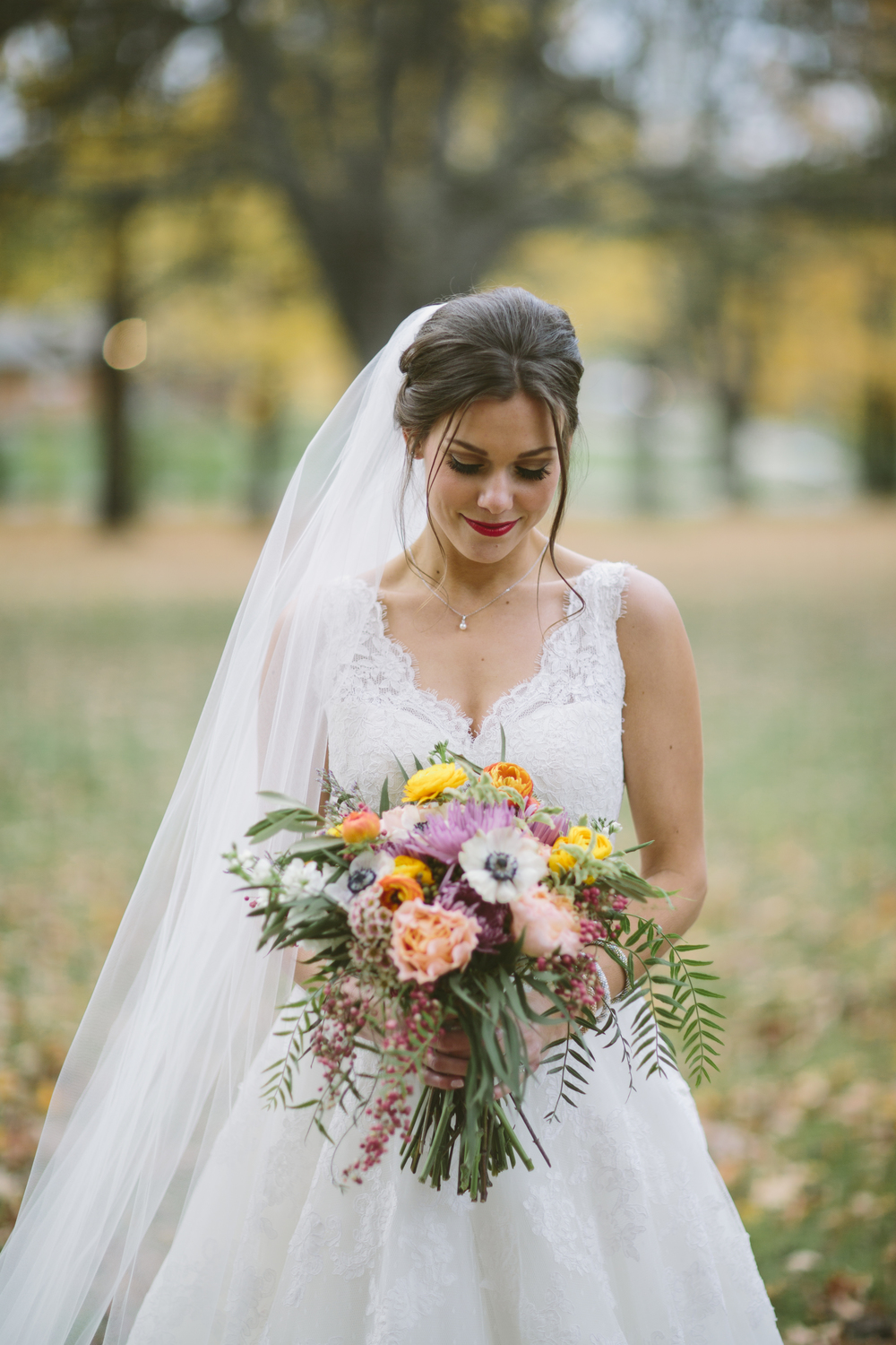 Fall bride with bouquet // Riverwood Mansion Wedding