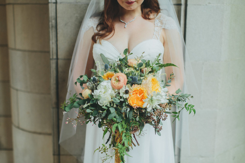Organic bridal bouquet with peach garden roses, ranunculus, and anemones // Nashville Wedding Florist
