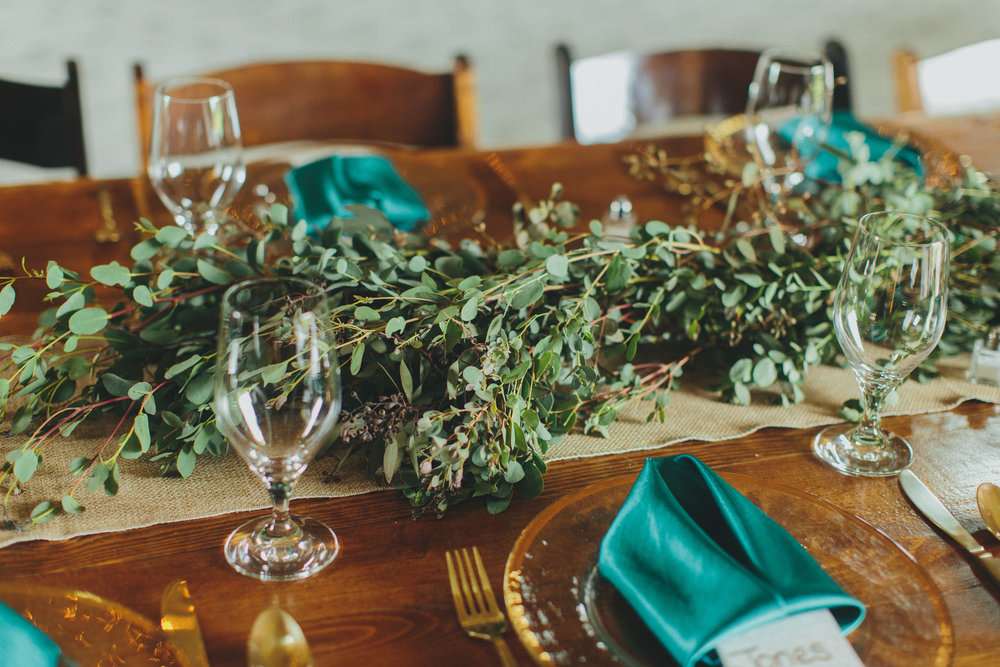 Lush greenery garland table runner // Nashville Wedding Florist