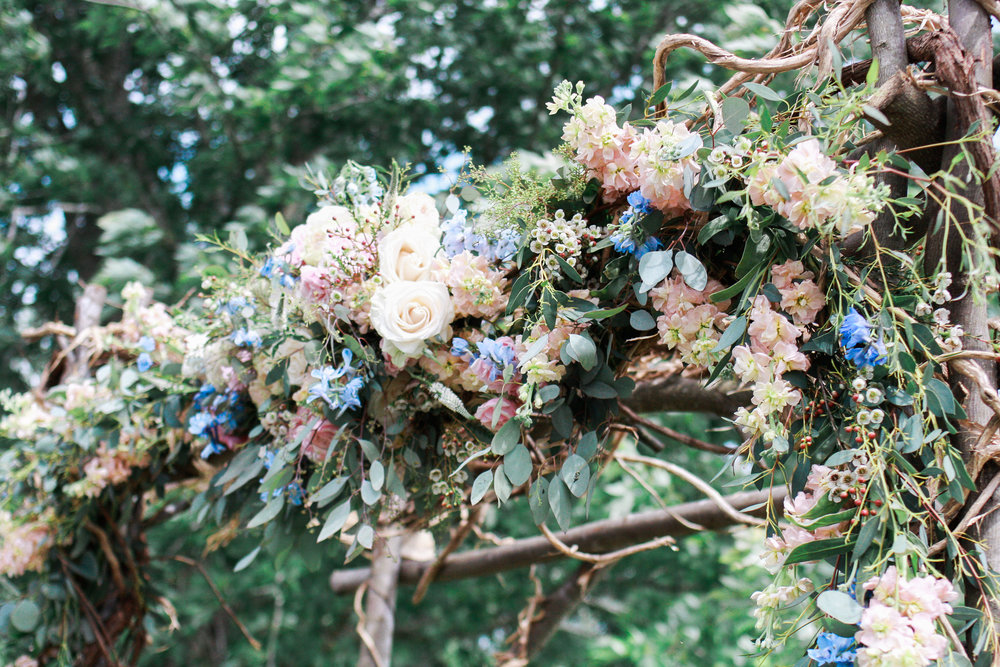 Rustic wedding arch with florals // Nashville Florist