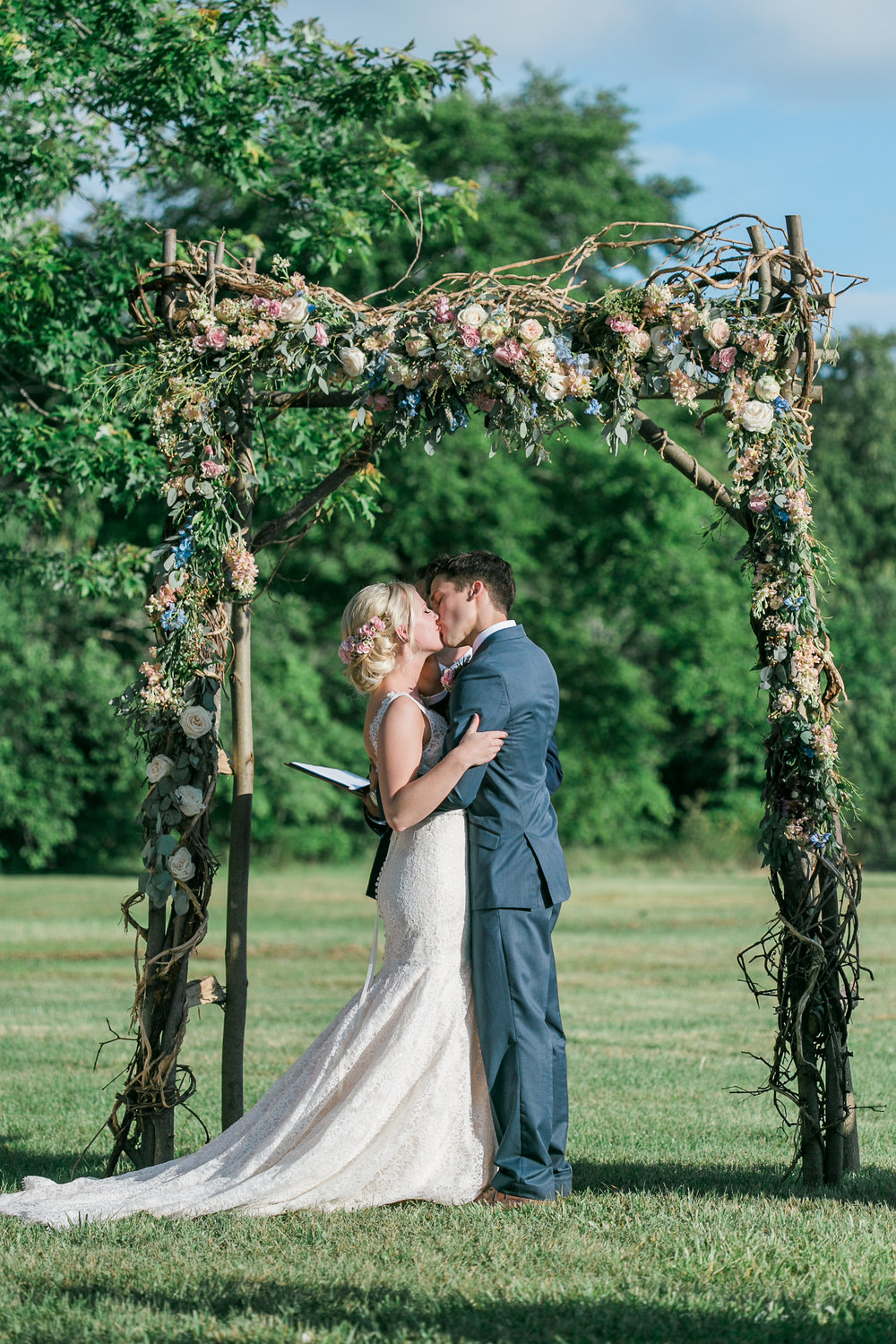 Wood, rustic arch with flowers // Nashville Wedding Floral Design