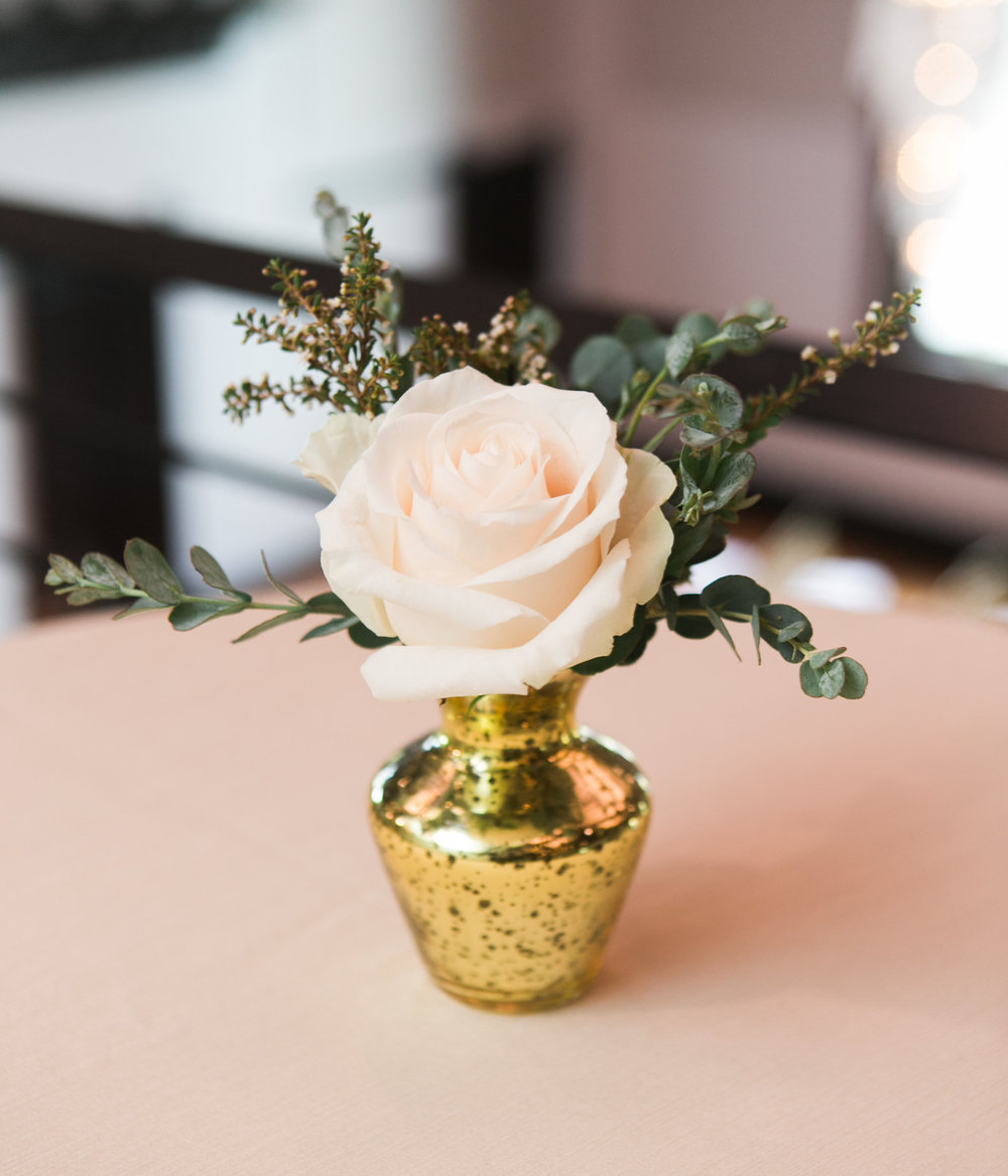 Gold mercury glass bud vases with greenery and blush rose