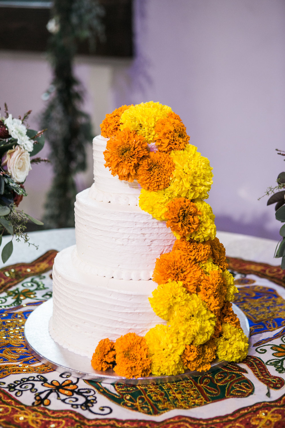 Cake with yellow marigolds // Nashville Wedding Florist