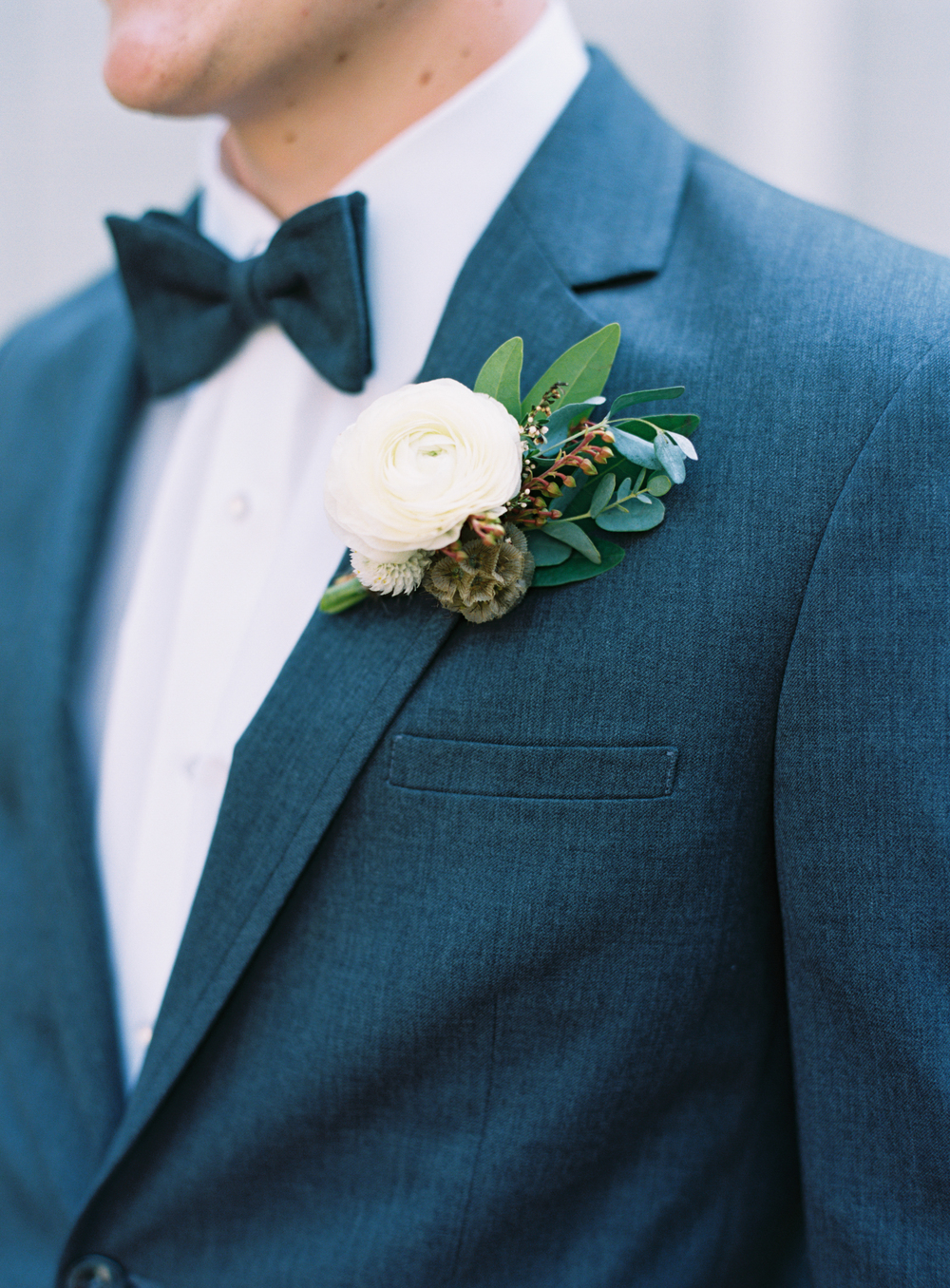 Natural, rustic boutonniere with ranunculus // Nashville Wedding Floral Design