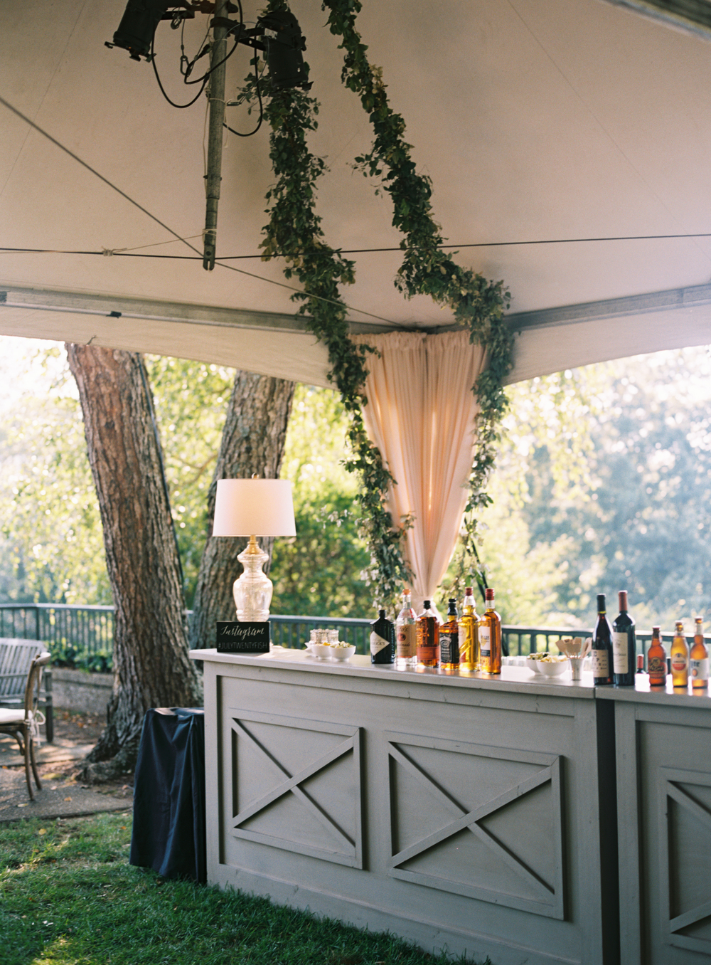 Tent with Garlands of Greenery // Belle Meade Wedding Floral Design