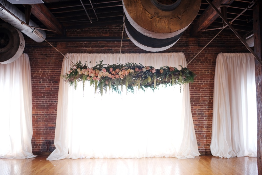 Hanging installation for wedding ceremony backdrop at Cannery One // Nashville Florist