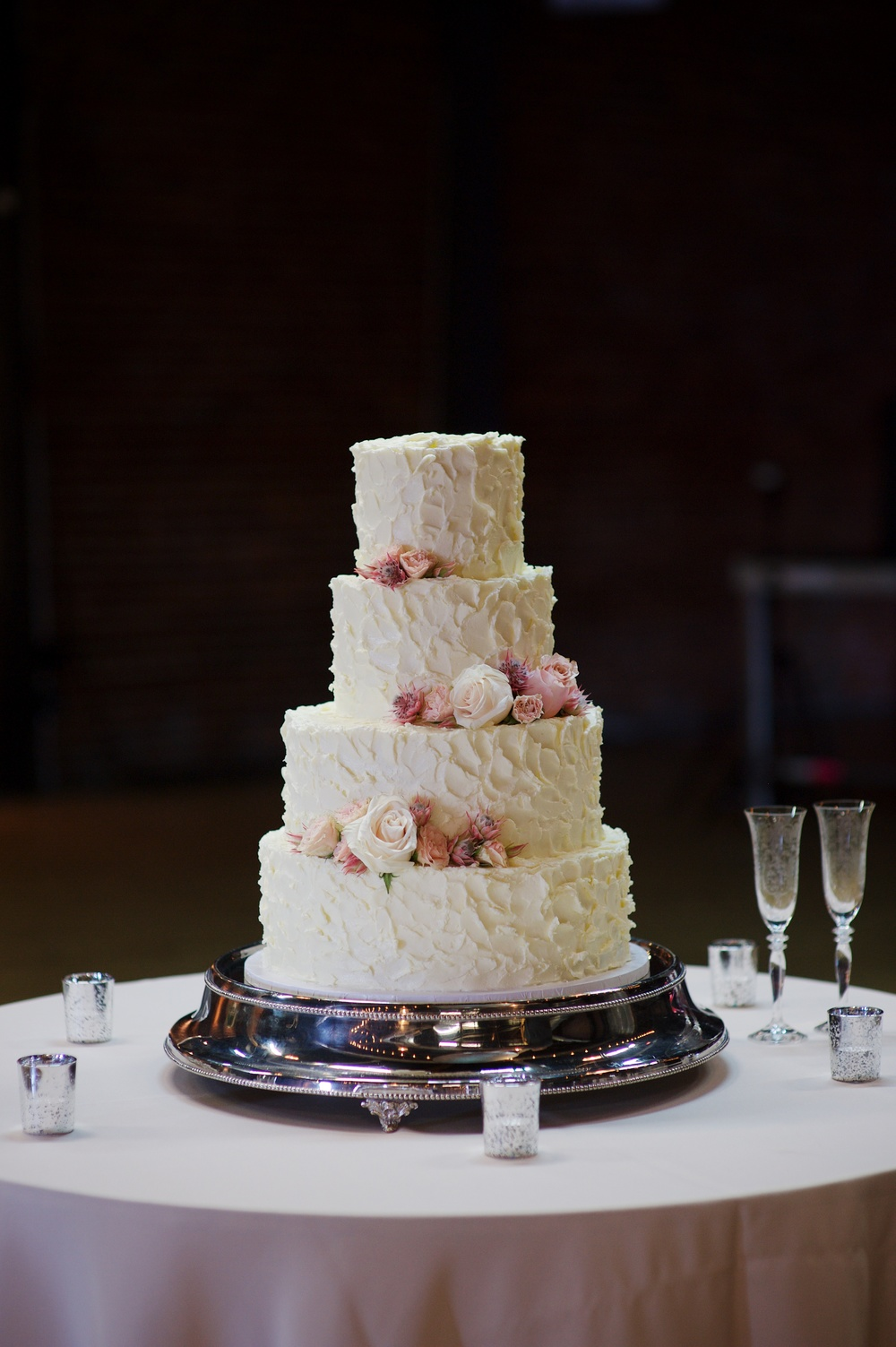 Wedding cake with blush and neutral floral accents // Nashville Wedding Florist