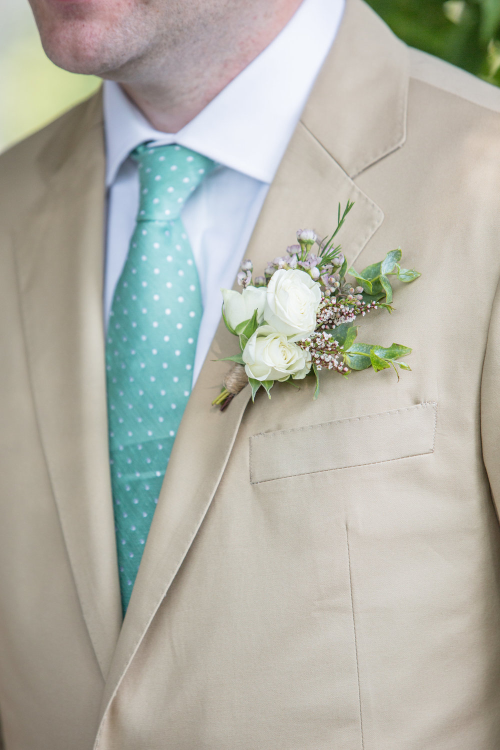 Cream and greenery boutonniere // Nashville Florist