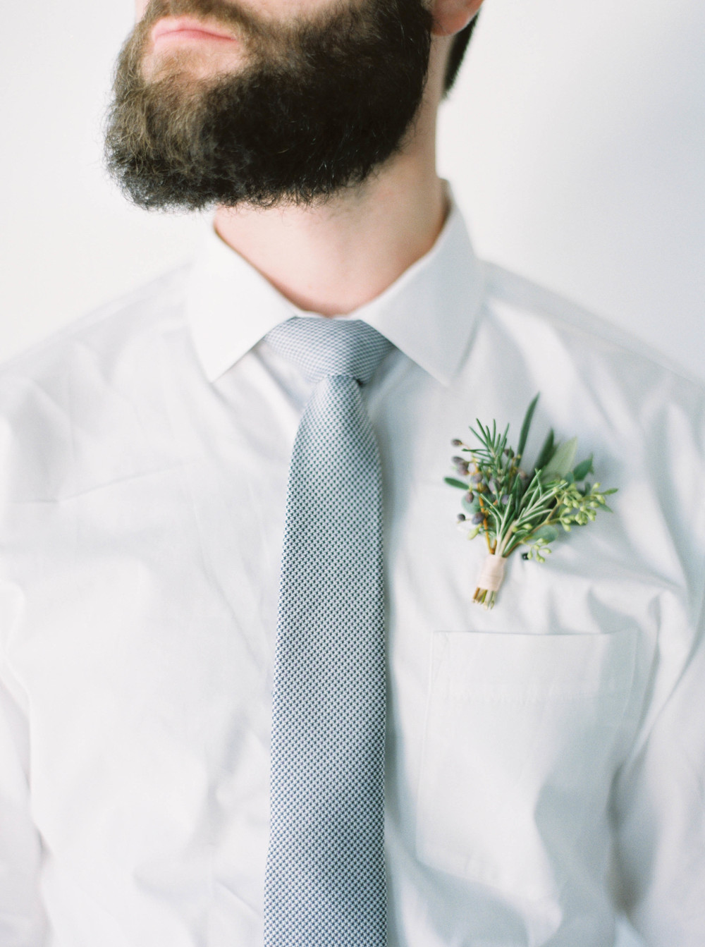 Herbs, greenery, and berry boutonniere // Natural Destination Floral Design