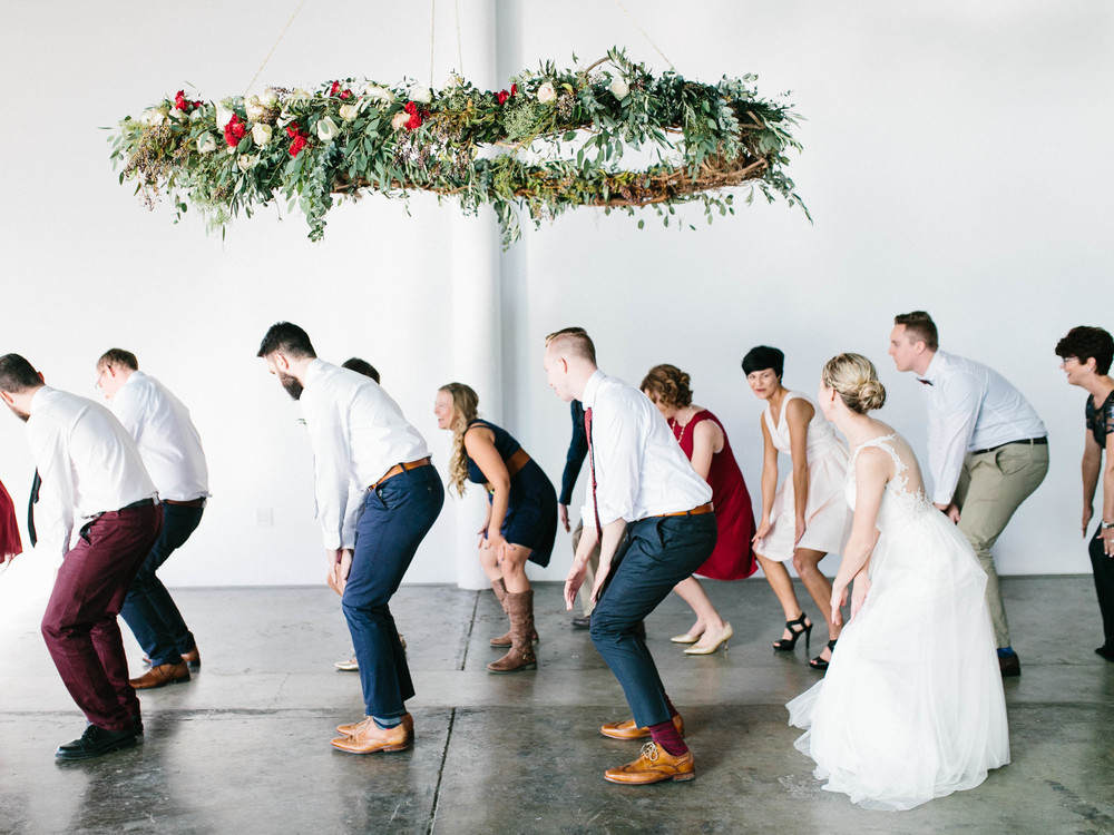Dancing under a suspended floral arrangement // Destination Wedding Florist