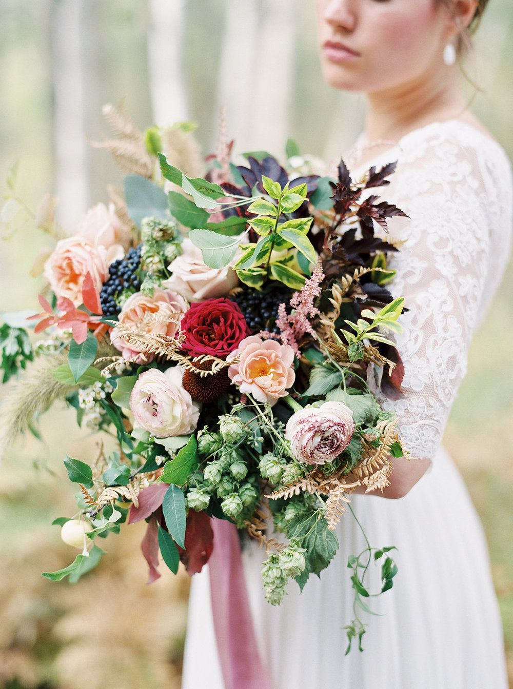 Trailing bridal bouquet with ranunculus, hops, and garden roses // Destination Florist