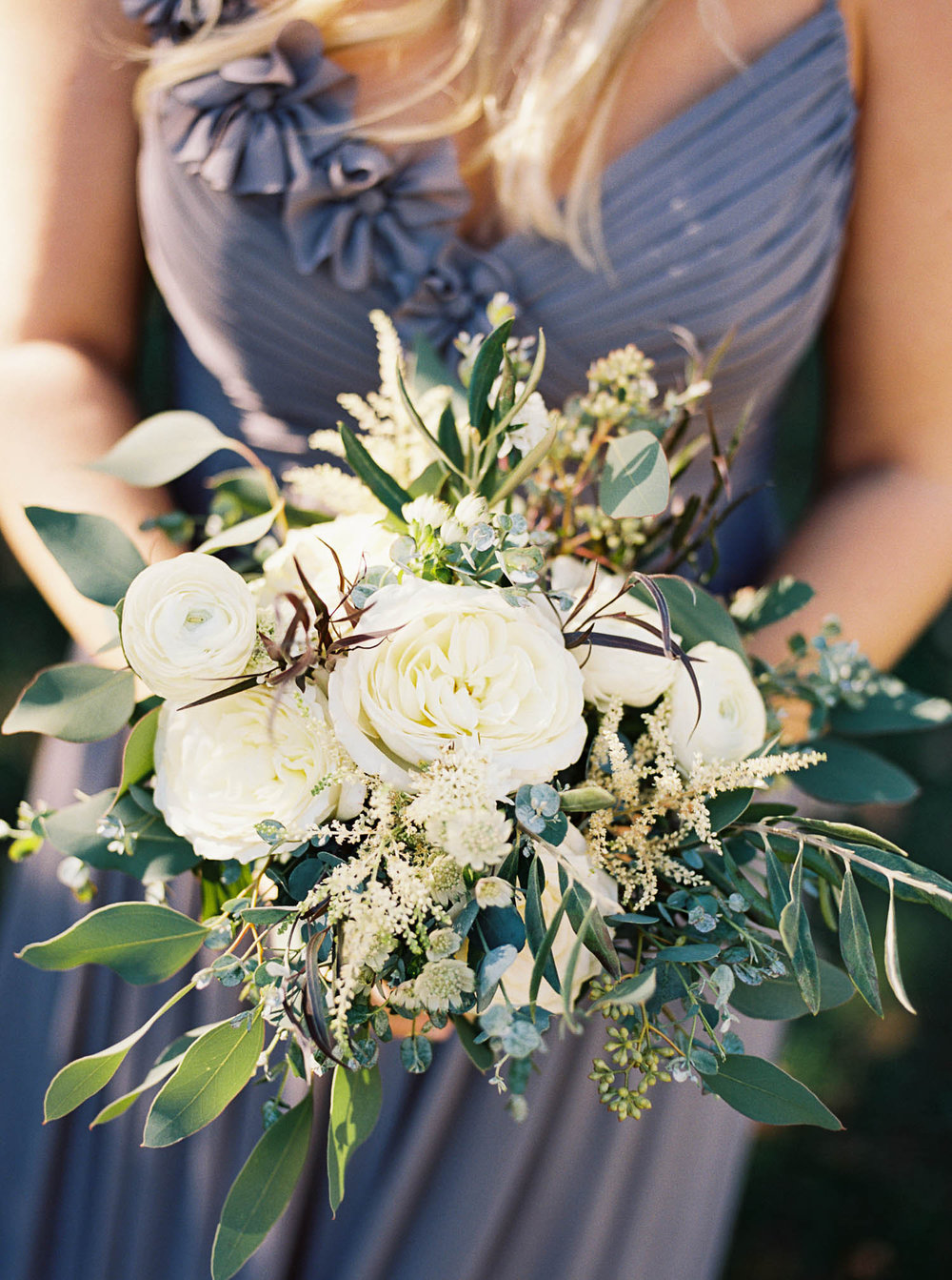 All white and greenery bridesmaid bouquet // Lush floral design