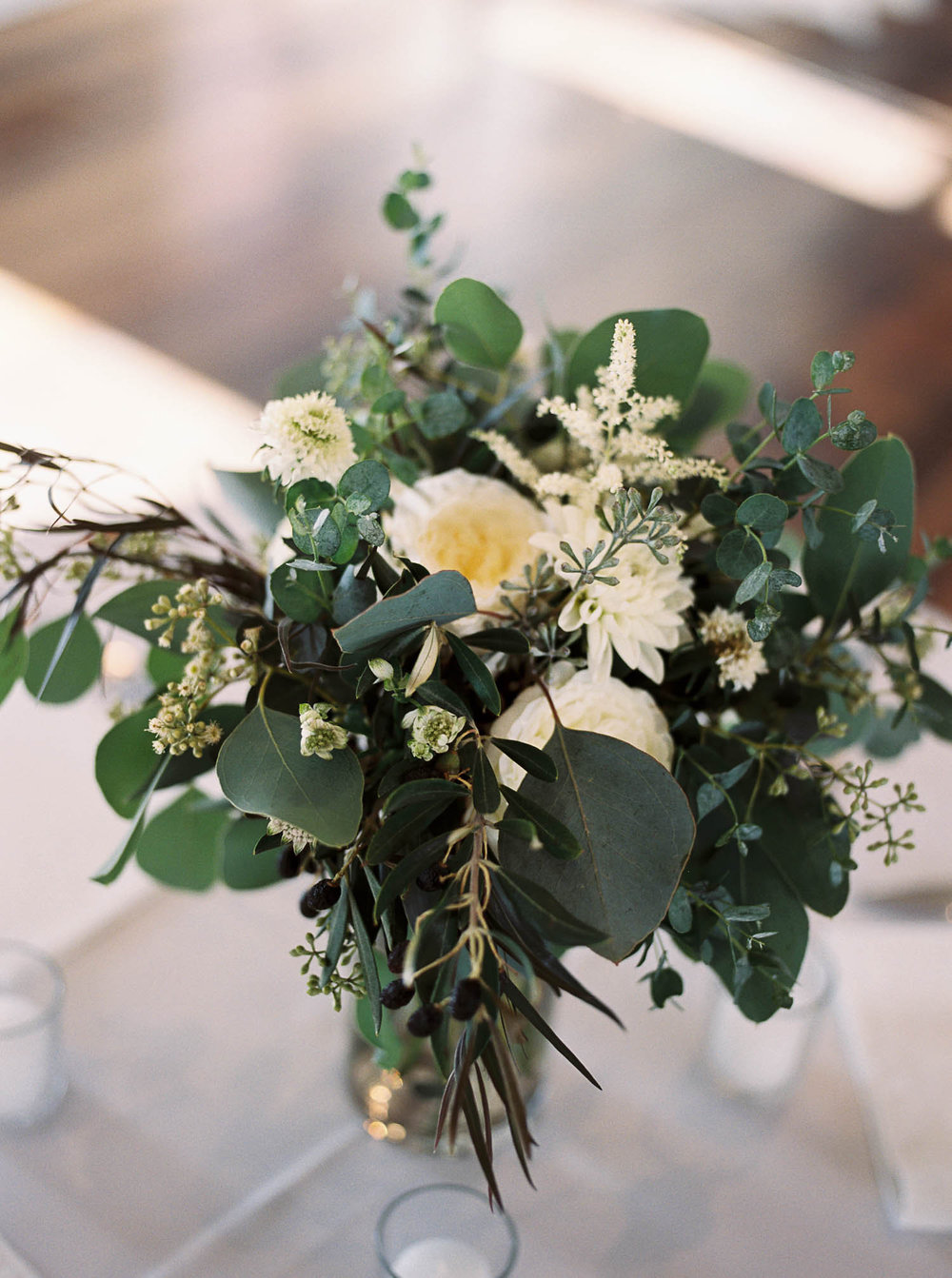 Lush, greenery heavy centerpiece // Destination Wedding Floral Design