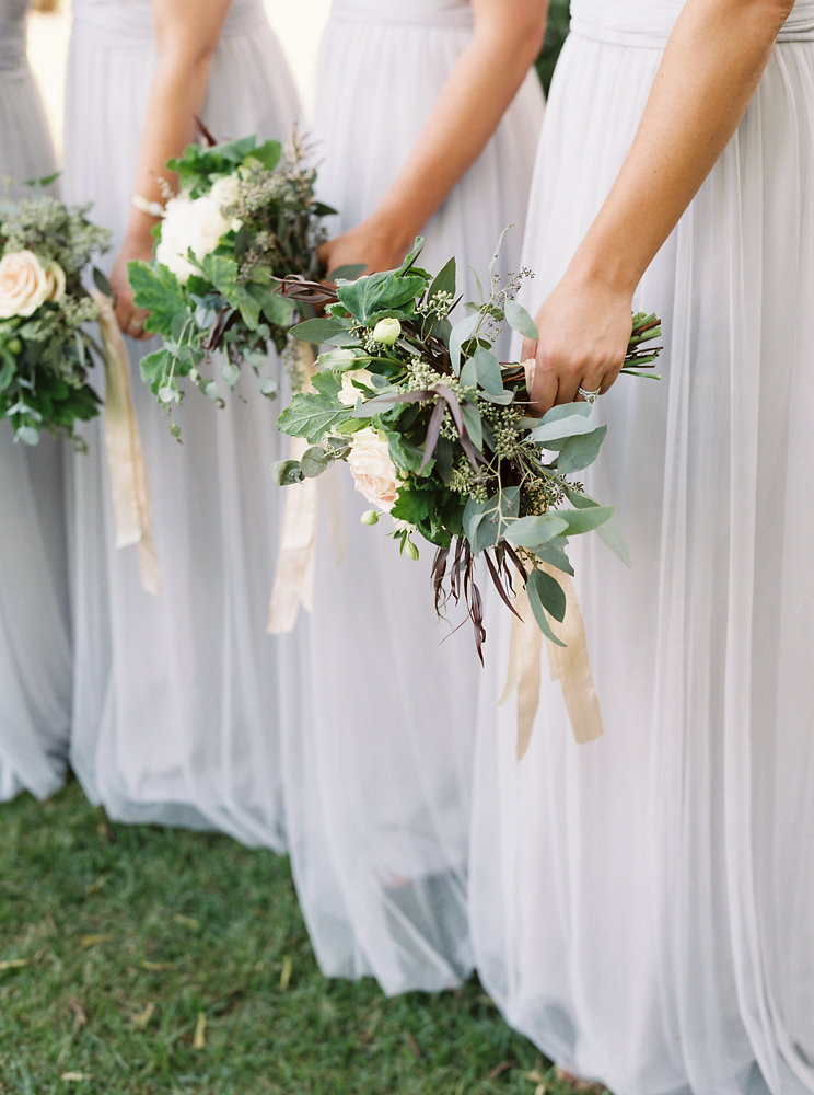 Soft blue bridesmaid dresses with blush, neutral, and greenery bouquets // Nashville Botanic Garden Wedding Florist