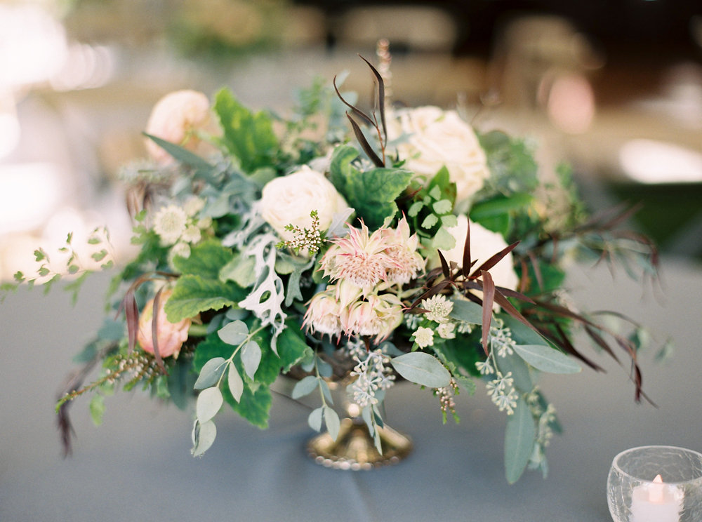 Organic, untamed centerpiece with protea and ranunculus // Natural Floral Design