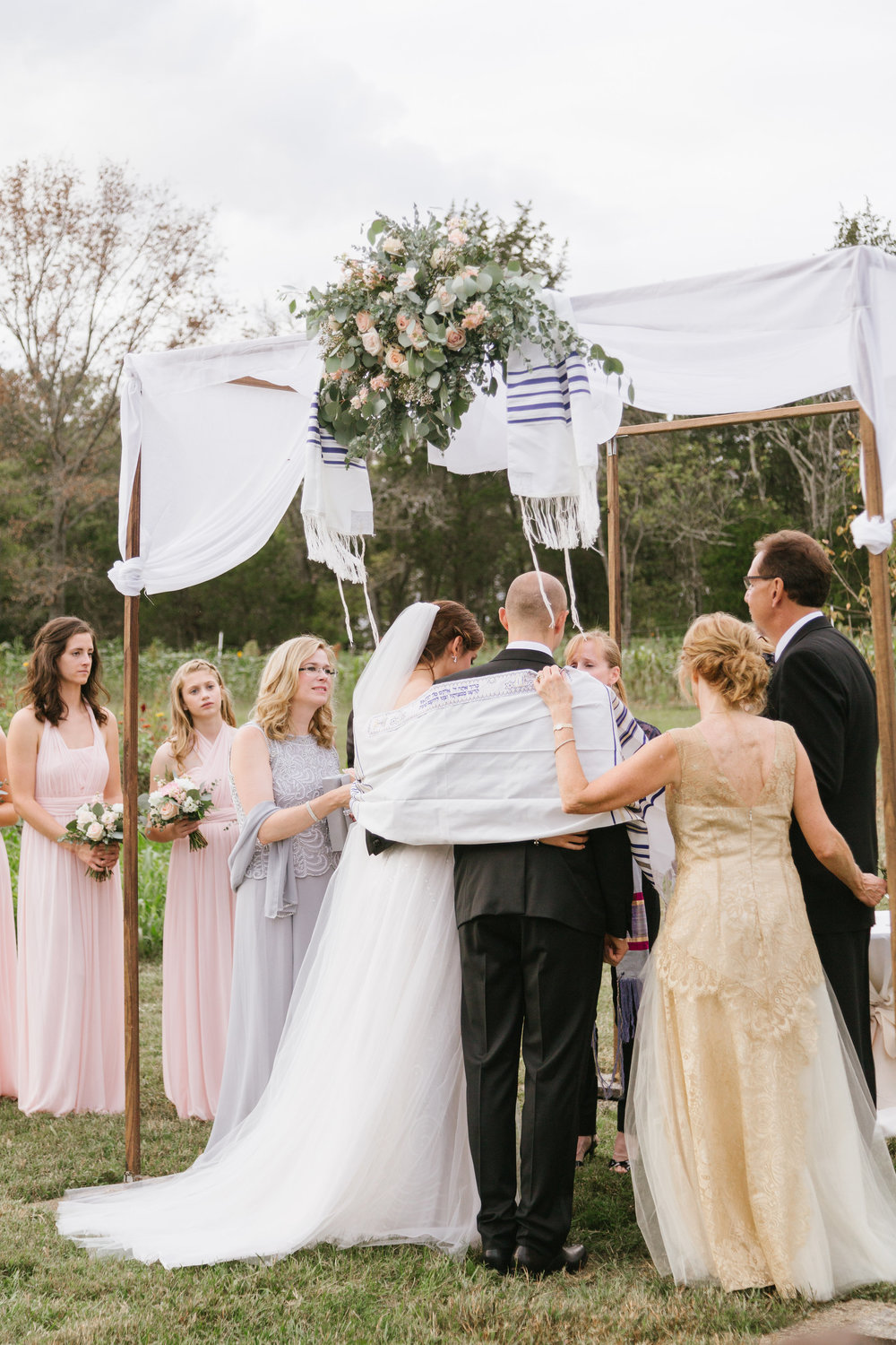 Wedding blessing under the chuppah // Nashville Wedding Florist