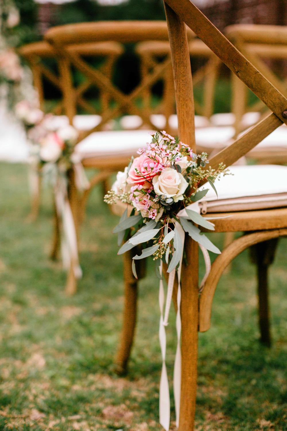 Simple aisle markers tied on with ribbon // Southern Wedding Floral Design
