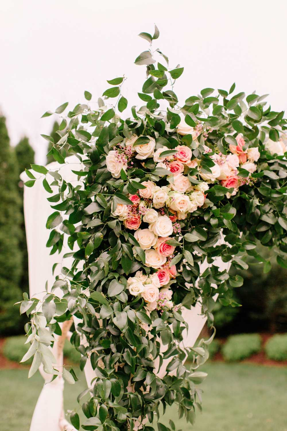 Rose details on a large chuppah // Wedding Ceremony Flowers