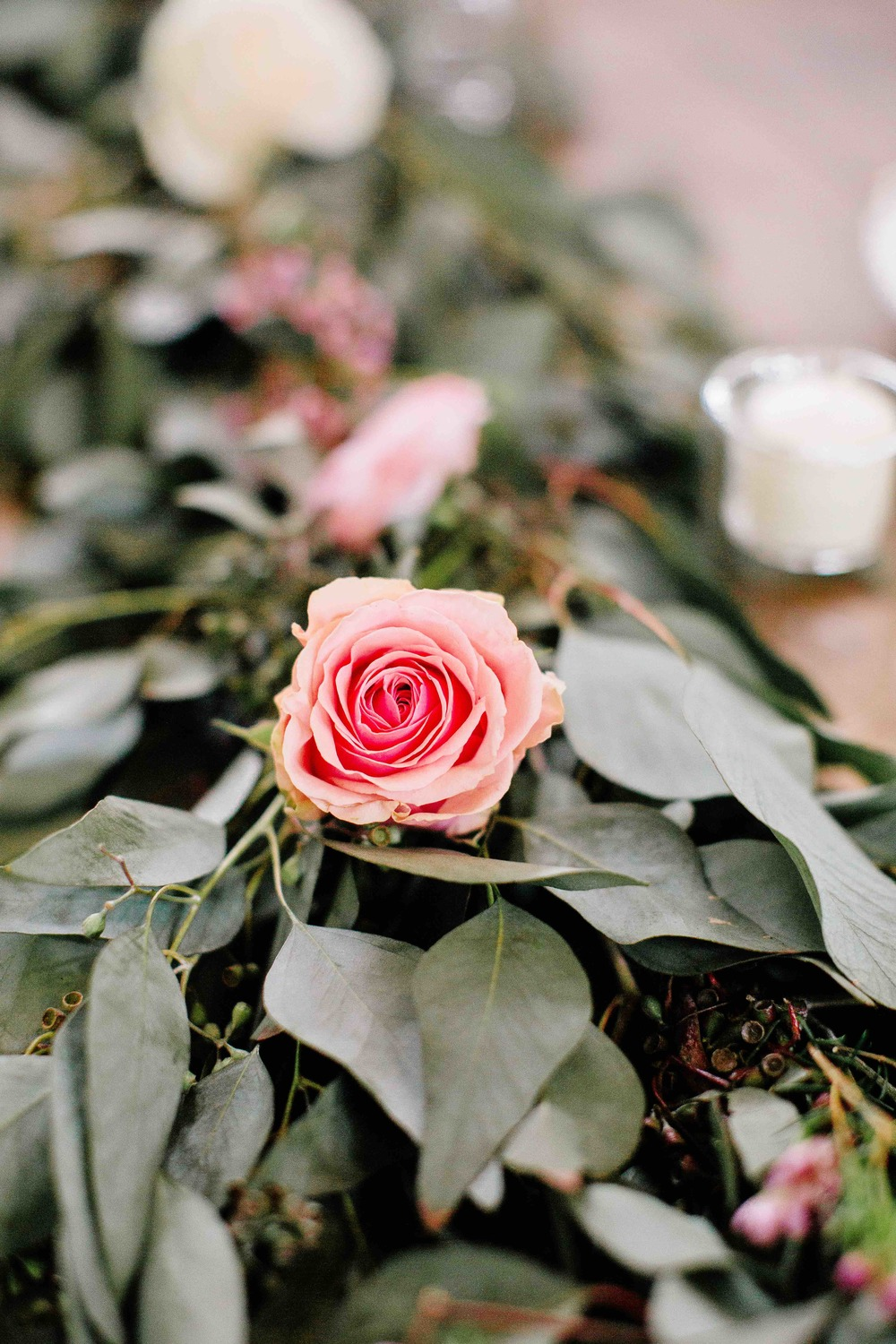 Rose accents in greenery table runners // Nashville Wedding Flowers