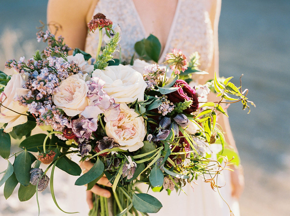 Lush bridal bouquet with lilac, sweet pea, garden roses, and ranunculus // Nashville Wedding Florist