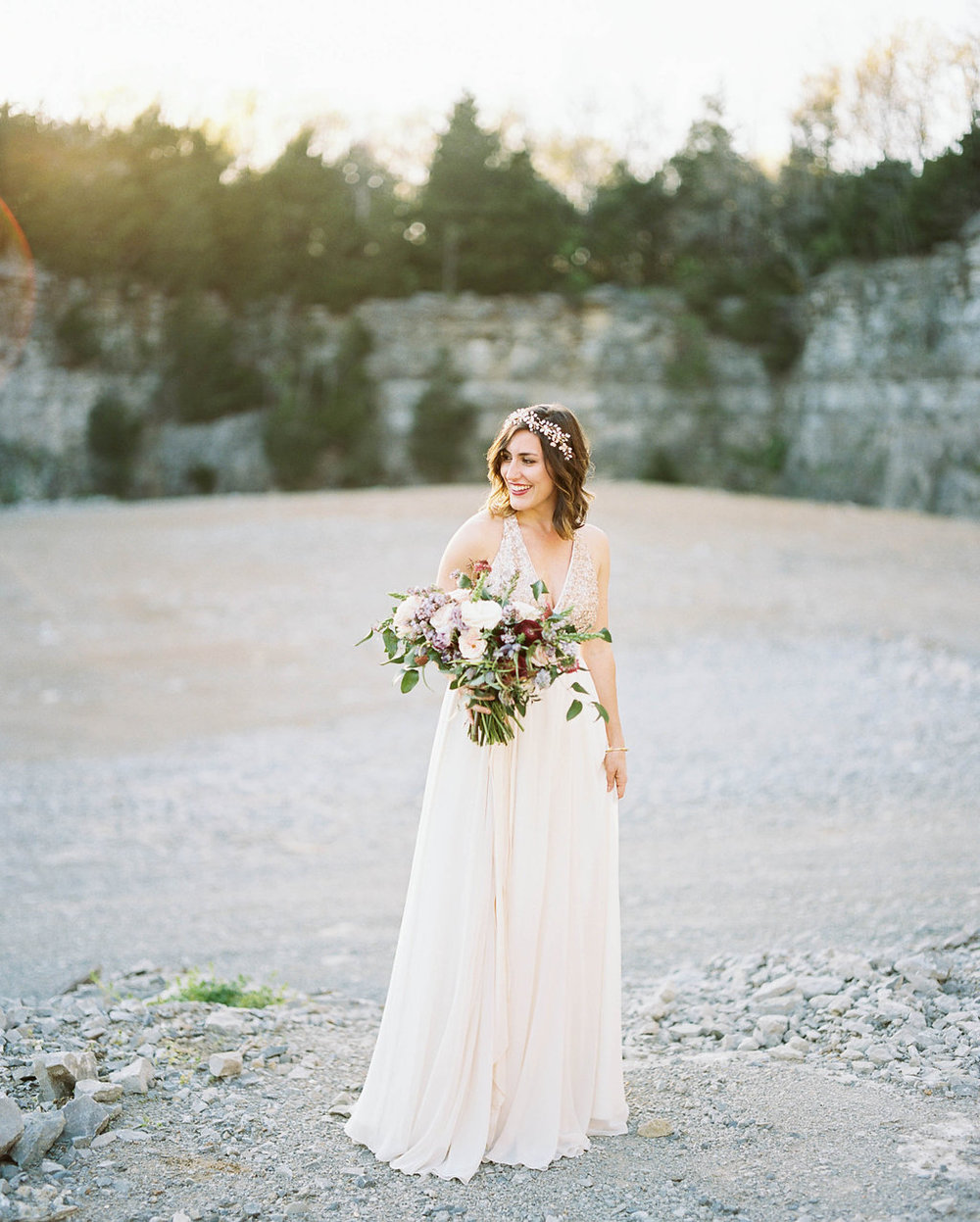 Rock quarry bridal portrait with lush, organic floral design // Nashville Florist