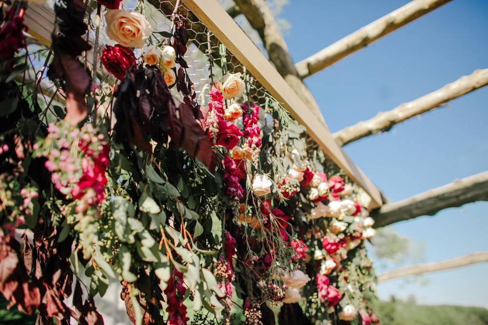 Vibrant floral installation for wedding ceremony backdrop // Destination Wedding Floral Design