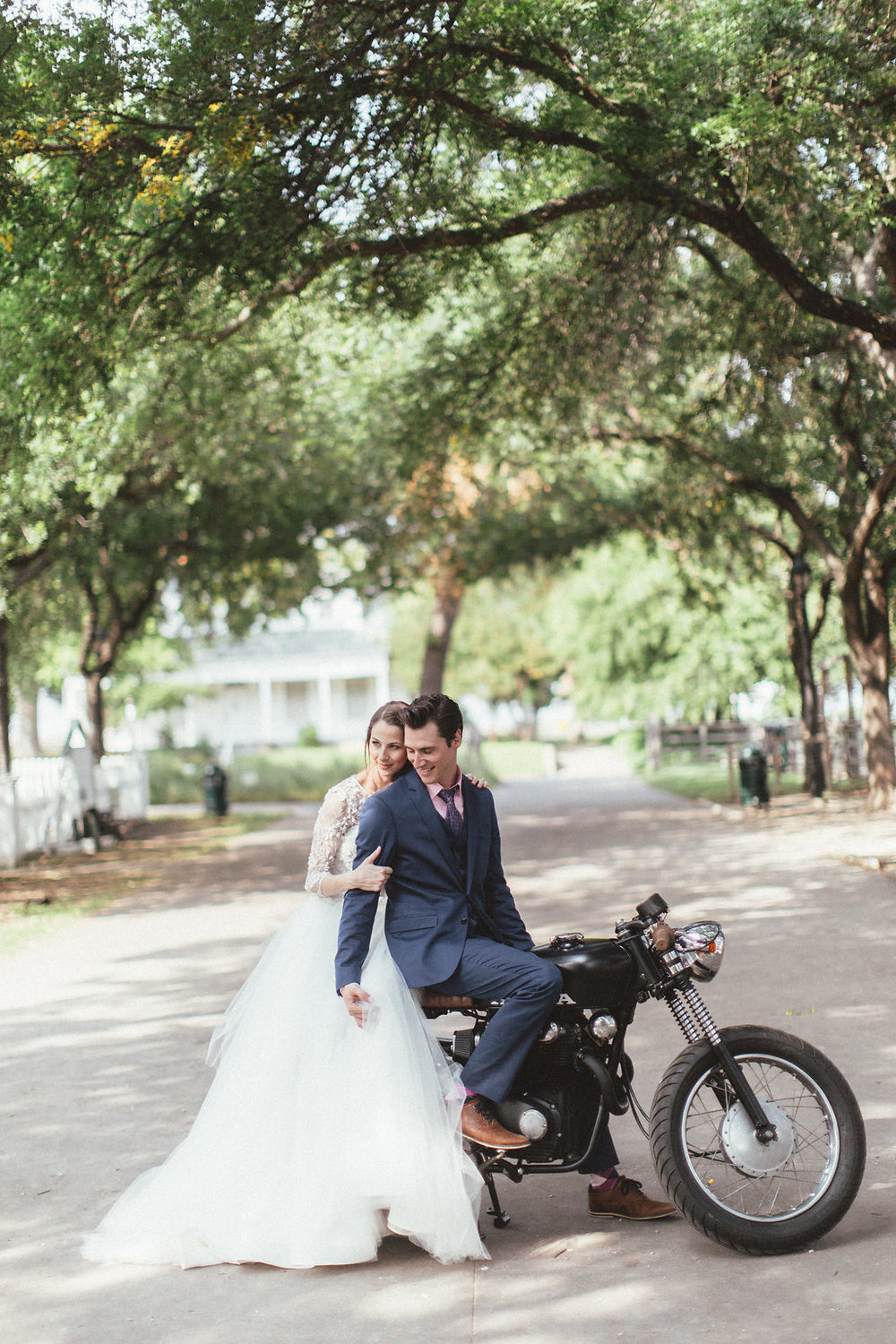 Bride and Groom on a motorcycle // Dallas Wedding Floral Design