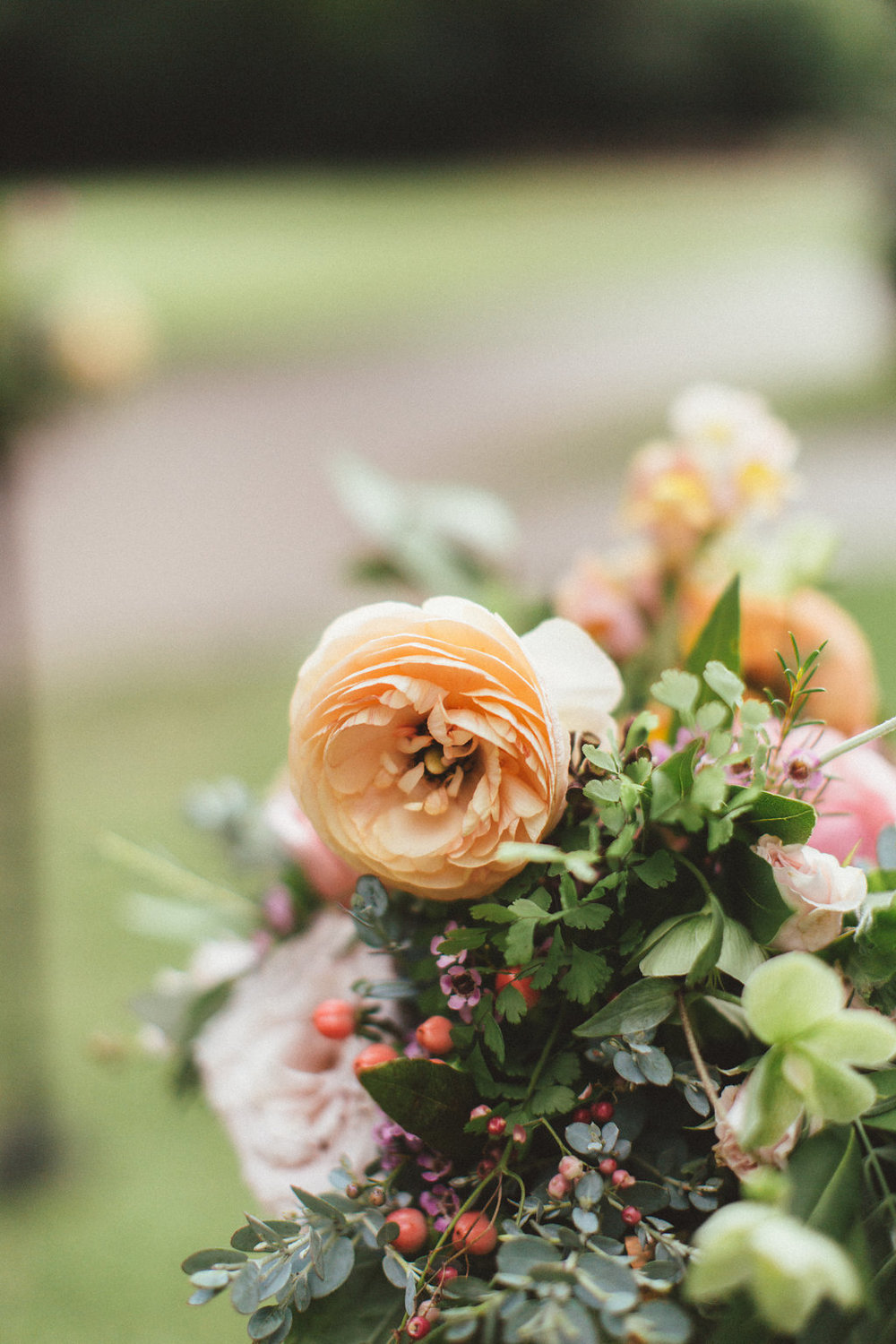 Peach ranunculus and lush greenery // Nashville Wedding Floral Design