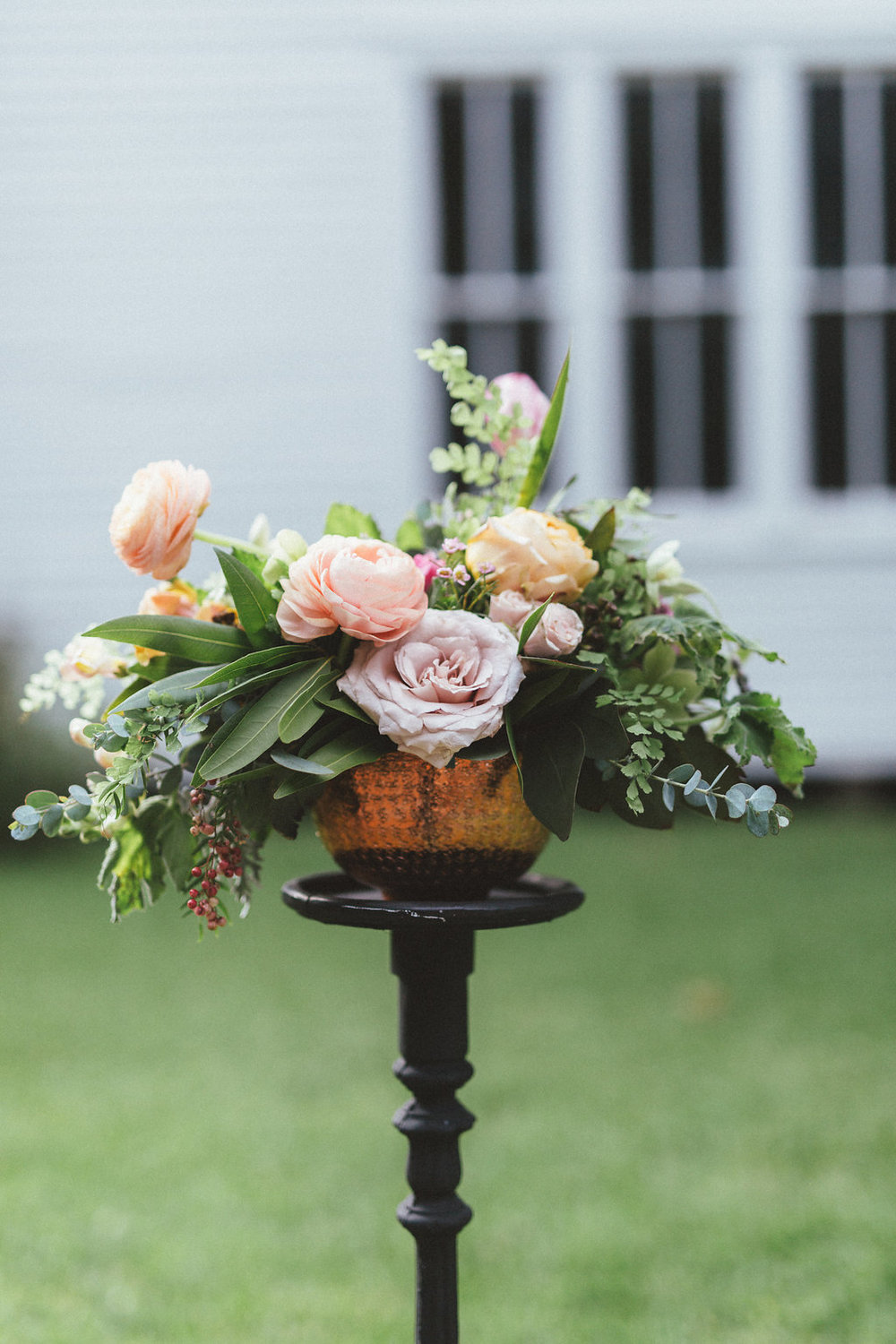 Copper bowl filled with peach and pink flowers // Natural Floral Design in Dallas/Nashville