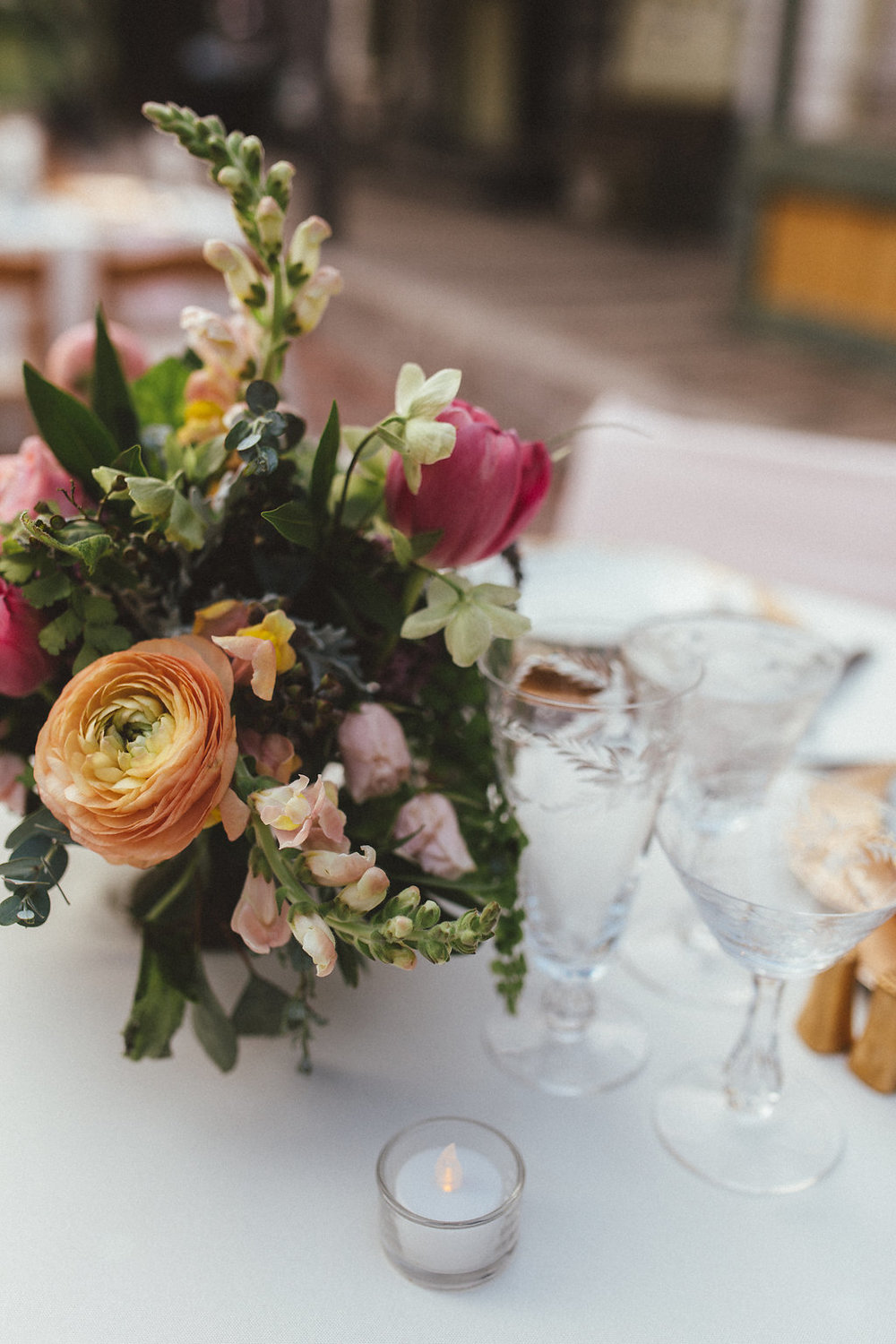 Peach ranunculus, pink tulips, natural greenery // Nashville Wedding Floral Design