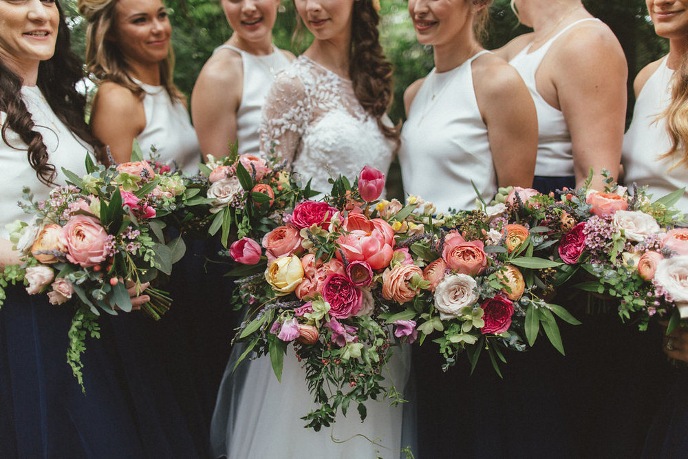Coral, pinks, and peach florals with lush, trailing greenery // Dallas Floral Design for Weddings