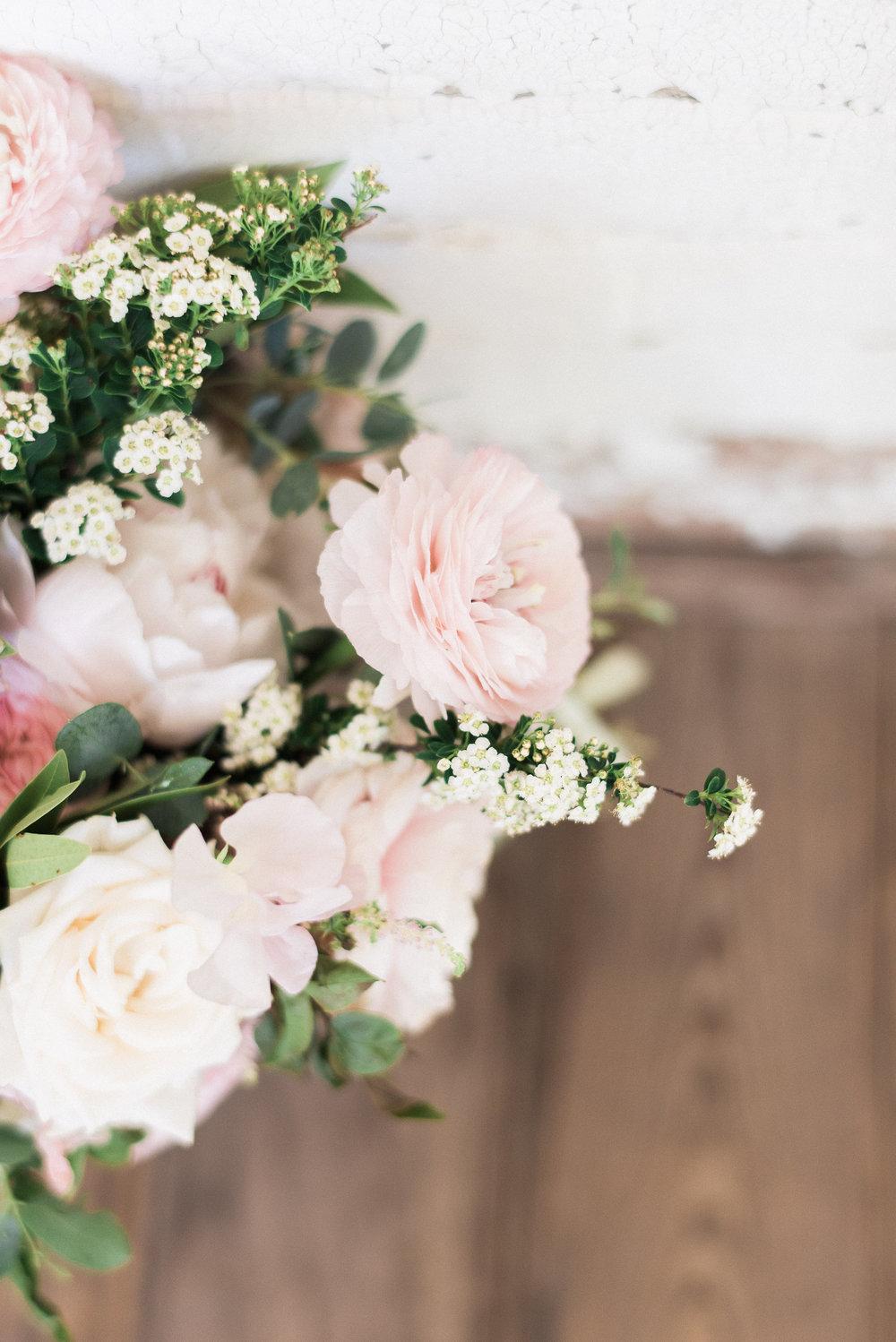 Blush and ivory bridal bouquet with peonies, ranunculus, and lush greenery // Nashville Wedding Florist