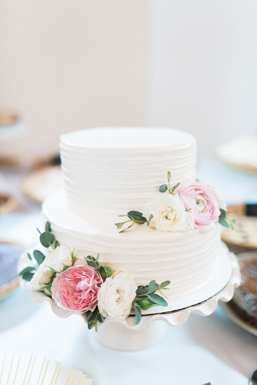 2 tier cake with soft pink and ivory floral accents // Nashville Wedding Florist