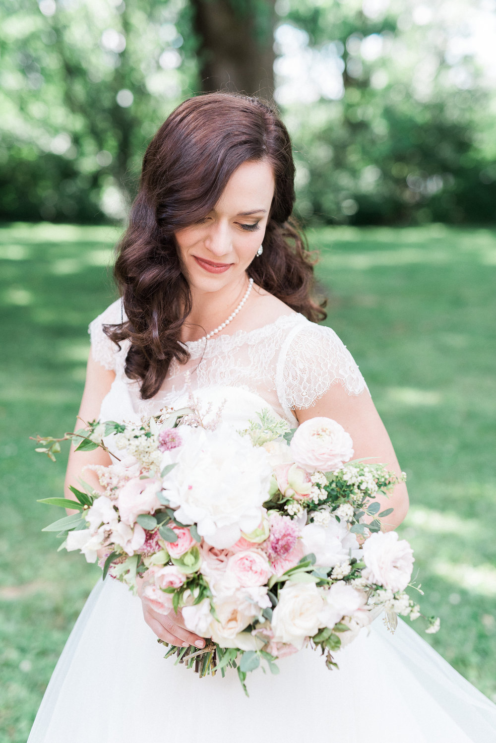 Garden inspired bridal bouquet with peonies, garden roses, and ranunculus // Nashville Wedding Florist