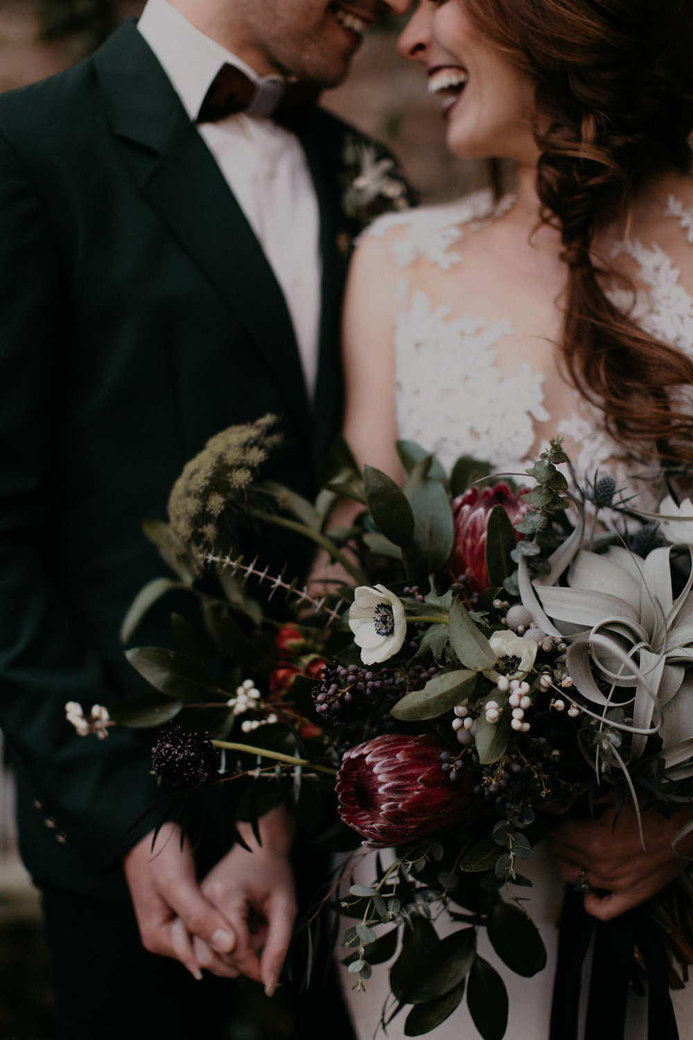 Wintry Bridal Bouquet with air plants, peonies, berries, eucalyptus, and loose, untamed greenery // Nashville Florist