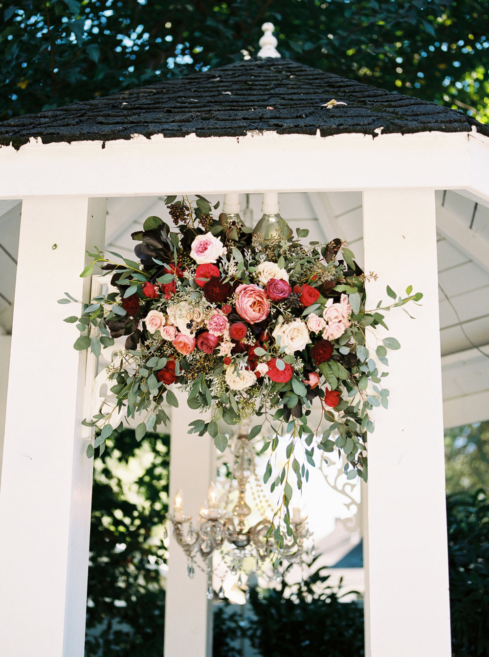 Gazebo Wedding Ceremony Backdrop with ombre pink to deep burgundy flowers // Nashville Wedding Florist